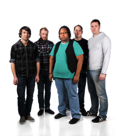 cool guy: Group of five young men standing over a white background Stock Photo
