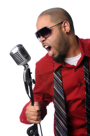 African American singer singing into vintage microphone photo