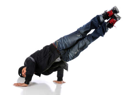 Africna American hip hop dancer performing a side hand and head stand