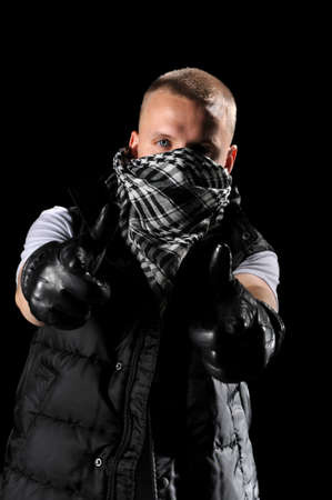 Hip hop dancer with handkerchief on face pointing