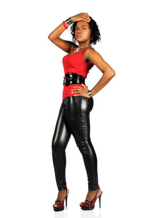 African American woman dressed in black leather pants and high heels
