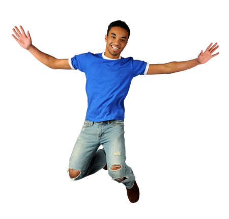 cool guy: Young man jumping isolated over a white background