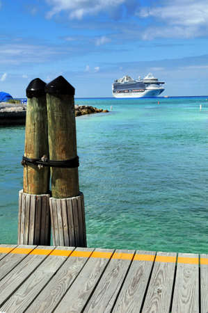 cruise travel: Port deck in Princess Cay Bahamas with cruise ship in background Stock Photo