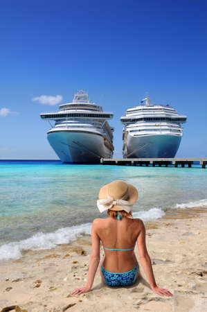 ship anchor: Woman relaxing on beach with cruise ships in background