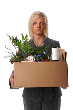 belongings: Sad businesswoman carrying belongings in box after loosing job