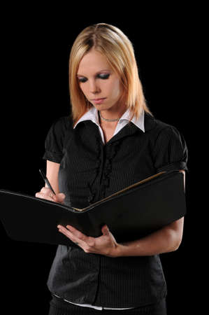 Attractive businesswoman writing isolated over black background Stock Photo - 7888406