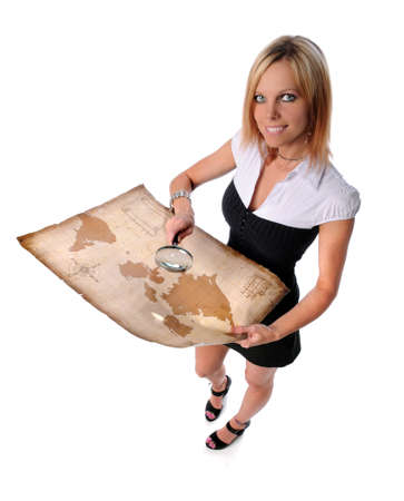 Beautiful businesswoman holding vintage map and magnifying glass Stock Photo - 7887860