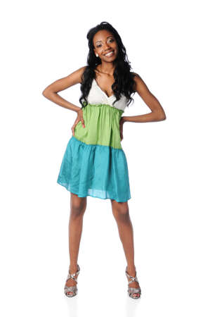 Young African American woman standing over white background