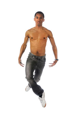 barechested: Barechested African American hip hop dancer jumping over a white background