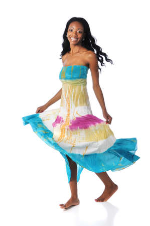 barefooted: Young African American woman barefooted wearing colorful dress