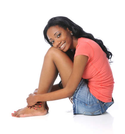 african american woman: Beautiful African American woman sitting over a white background