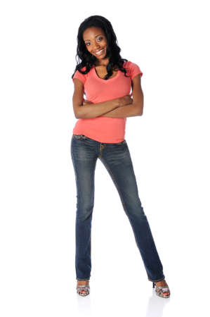Beautiful African American woman with arms crossed dressed in jeans and high heels  Stock Photo