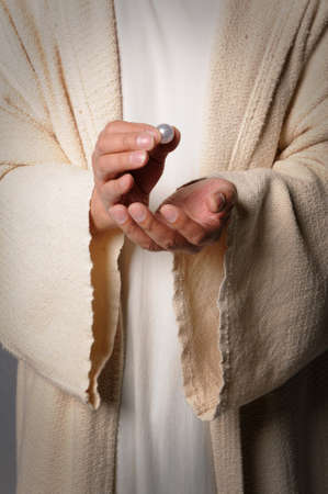 parable: Hands of Jesus holding pearl - The parable of the pearl of great price Stock Photo