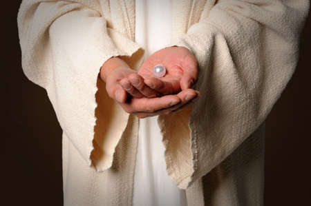 parable: Hands og Jesus holding pearl - The parable of the pearl of great price
