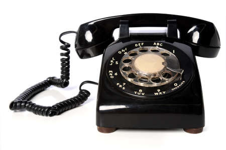 dial plate: Vintage black telephone over a white background