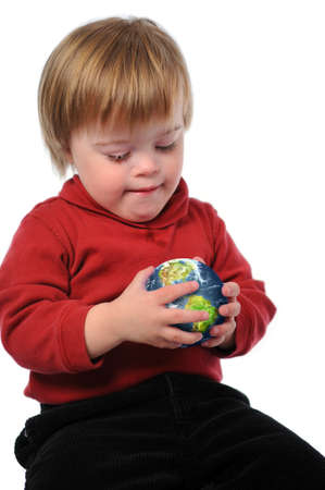 handicapped: Child with Down Syndrome holding the earth in his hands isolated over a white background. Stock Photo