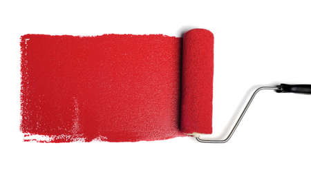 Paint roller leaving stroke of red paint over a white background 스톡 콘텐츠
