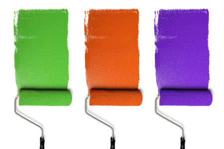 Paint Rollers with secondary colors isolated over white background photo