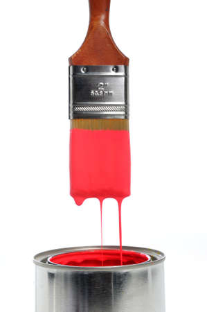 paints: Brush dripping red paint into an open can