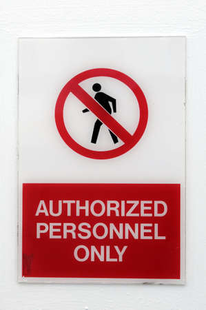 Authorized Personnel Only Side attached to wall photo