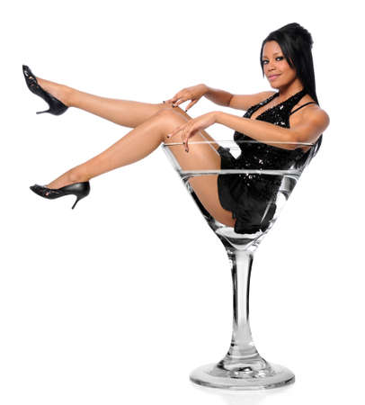 martini glass: Beautiful African American woman sitting in martini glass Stock Photo
