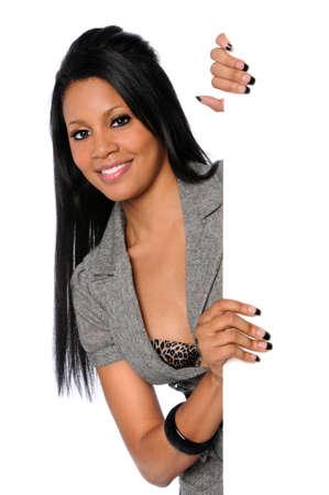 Beautiful African American businesswoman holding blank sign Foto de archivo