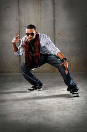 African American Hip Hop dancer performing over grunge background