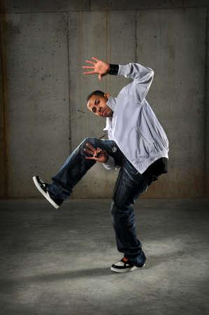 African American hip hop dancer performing over grunge background Imagens
