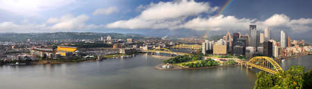 pennsylvania: Panoramic view of the city of Pittsburgh with rainbow in late afternoon Stock Photo