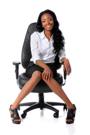 chairs: Young African American businesswoman sitting on office chair isolated over white
