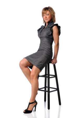stool: Young businesswoman sitting on black stool isolated over white