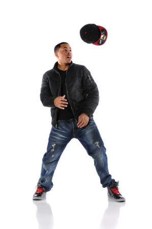 African American hip hop dancer throwing hat isolated over white photo