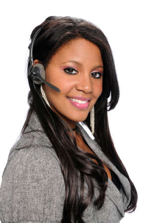 Friendly African American woman with headset isolated over white