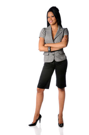 gorgeous businesswoman: African American businesswoman with arms crossed isolated over white background Stock Photo