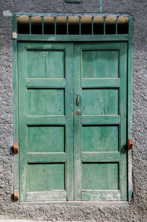 Old grunge green door with paint chipping photo