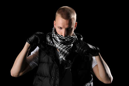 Hip hop dancer with scarf isolated over black background photo