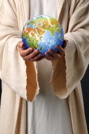 hands holding earth: The hands of Jesus holding planet earth Stock Photo