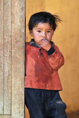 needy: CAJABAMBA PERU - SEPTEMBER 8: Portrait of poor young boy, Cajabamba, Peru on September 8, 2009