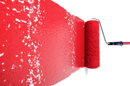 paintings: Pain roller with red paint on white wall