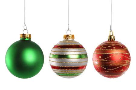 christmas deco: Tres los adornos de Navidad aislados sobre fondo blanco  Foto de archivo