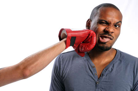 African American man getting hit on face by gloved hand photo