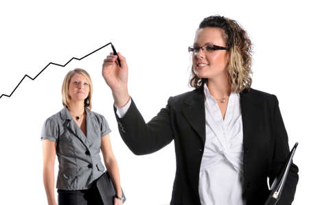 coworker: Businesswoman drawing growth chart while co-worker looks on