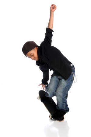 skater boy: Young African American skateboarder performing trick isolated over white background