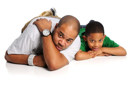 African American father and son laying on white floor Stock Photo - 7956194