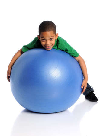 1 person: African American child playing with large ball over white background