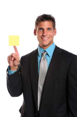 Empresario sosteniendo nota adhesiva aislado sobre fondo blanco  Foto de archivo - 7956202
