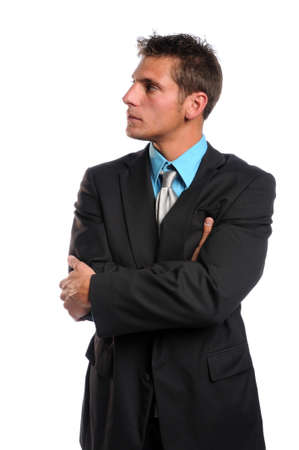 Businessman with arms crossed looking to the side isolated over white background photo