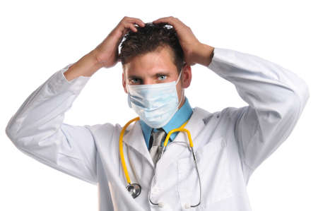 Distraught doctor with hands on head isolated over white background photo