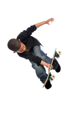 Young skateboarder jumping isolated over white background photo