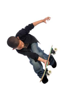 skateboarding tricks: Young skateboarder jumping isolated over white background